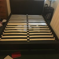Black queen-sized bed frame