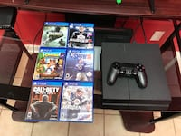 black Sony PS4 console with controller and game cases Alabaster, 35007