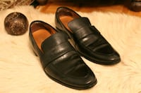 pair of black leather penny loafers size 11 Toronto, M1J 2H6