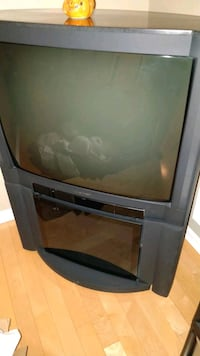 gray CRT television and stand