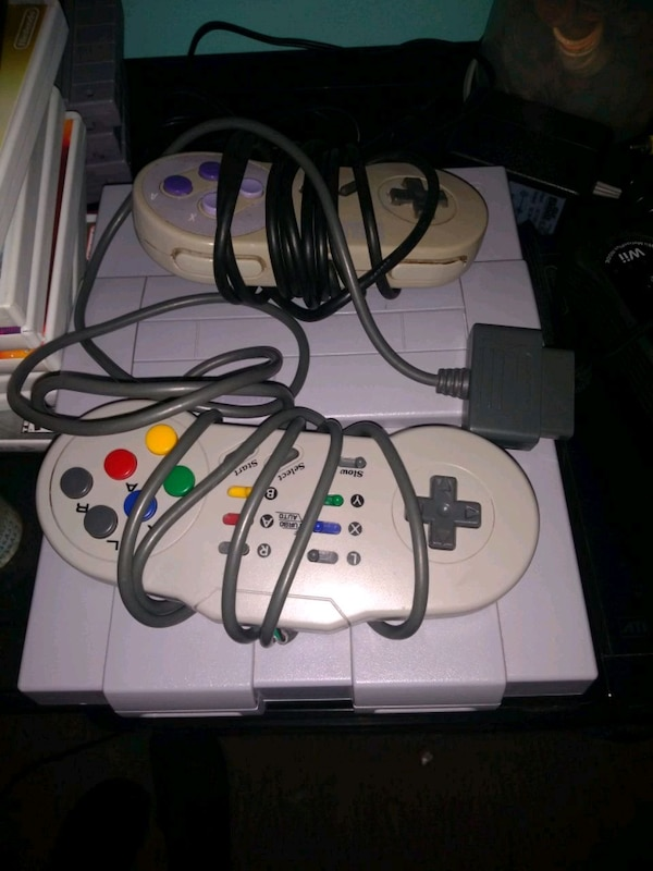 white Nintendo 64 console with controller