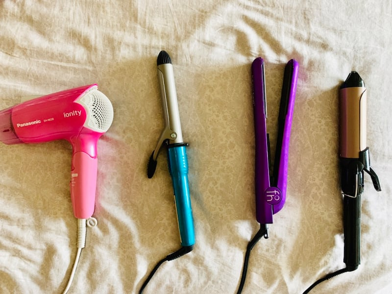 2 hair curling irons and one hair straightener  2fdca136-19c3-4312-b406-ae6314280ee9