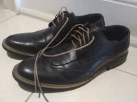 pair of black leather shoes 554 km