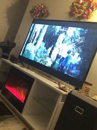 LG TV 65inch with a table that comes with a fireplace Edmonton, T6L 5S1