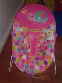 baby's pink, white, blue, and yellow bouncer
