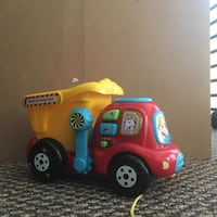 yellow, red, and blue Drop & Go toy dump truck 1291 mi