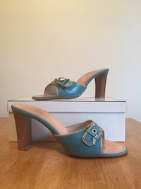 pair of blue Coach chunky heels sandals