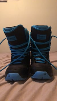 Pair of black-and-blue firefly snowboard boots. Size 8. Kelowna, V1X 5J3