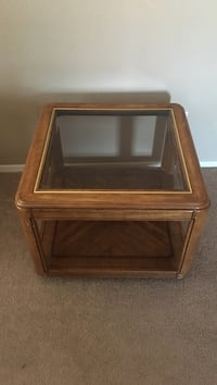 clear glass table with brown wooden frame and base $20.00 each there is two