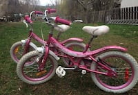 two kid pink bicycles