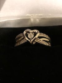 New....Ring with white sapphires. Still in box