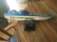 white and blue R/C boat toy