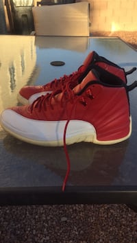 pair of red-and-white Air Jordan 12 Las Vegas, 89101