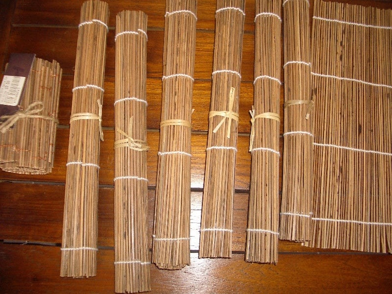 New. Very cool bamboo placemats, coasters and runner set c9c5b542-abf0-43ab-b18c-ff50f5766d28