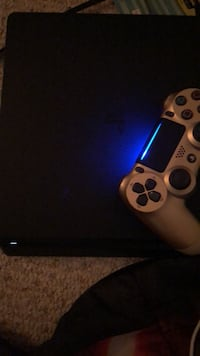 black Sony PS4 console with controller Woodbridge, 22193