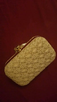 white and brown leather wristlet Winnipeg, R3L 0N4