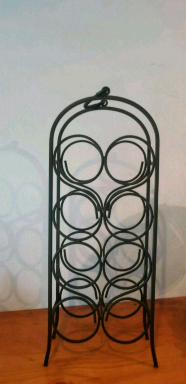black metal candle holder rack