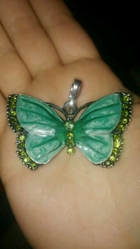 green and gold-colored butterfly pendant 777 km