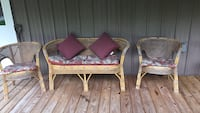Antique Rattan wicker Setee with 2 chairs. 40 years old. Always stored indoors or under shelter. Includes pillows and cushions Auburn, 13021