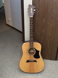 brown and black acoustic guitar Buffalo Grove, 60089