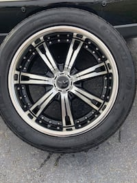 Chrome multi-spoke car wheel with tire Brentwood