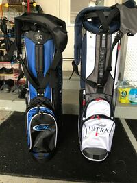 two assorted-brand blue and white golf bags