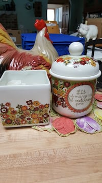 two white, green, red, and purple floral ceramic c
