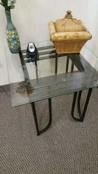 rectangular glass top table with black metal base
