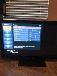 black flat screen TV with remote Palm Bay, 32909