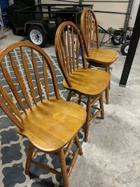 Three bar height swivel chairs