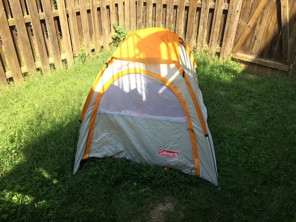 White and yellow Coleman outdoor tent