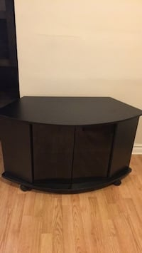 Black wooden tv stand with flat screen television Montreal, H9J 3S6
