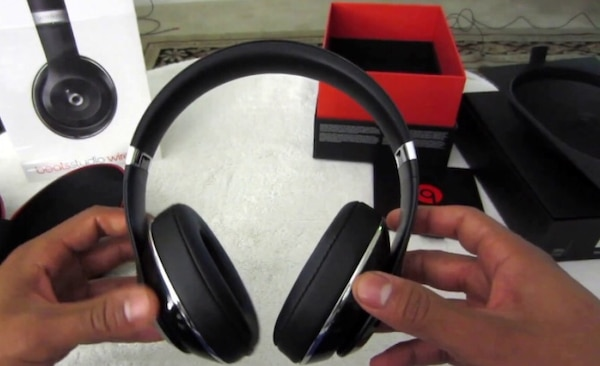 black and red corded headphones