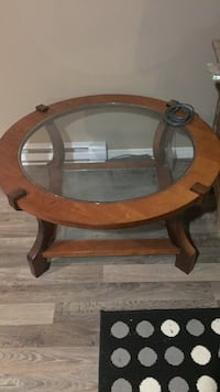 round brown wooden framed glass-top side table Saint-Georges, G5Y 1B5