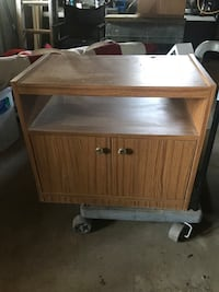 Brown real wood TV stand. Very heavy  Middletown, 45044