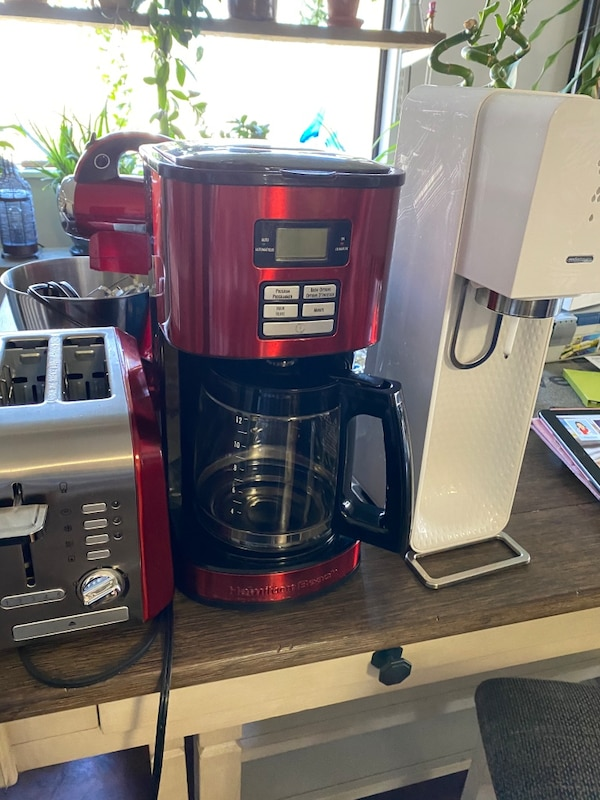 Red coffee maker, toaster and mixer  a17a0d07-66f3-45c4-8aba-b858e5418fcd