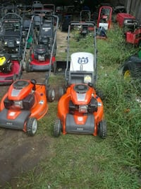 two red and black push mowers Fayetteville, 28314