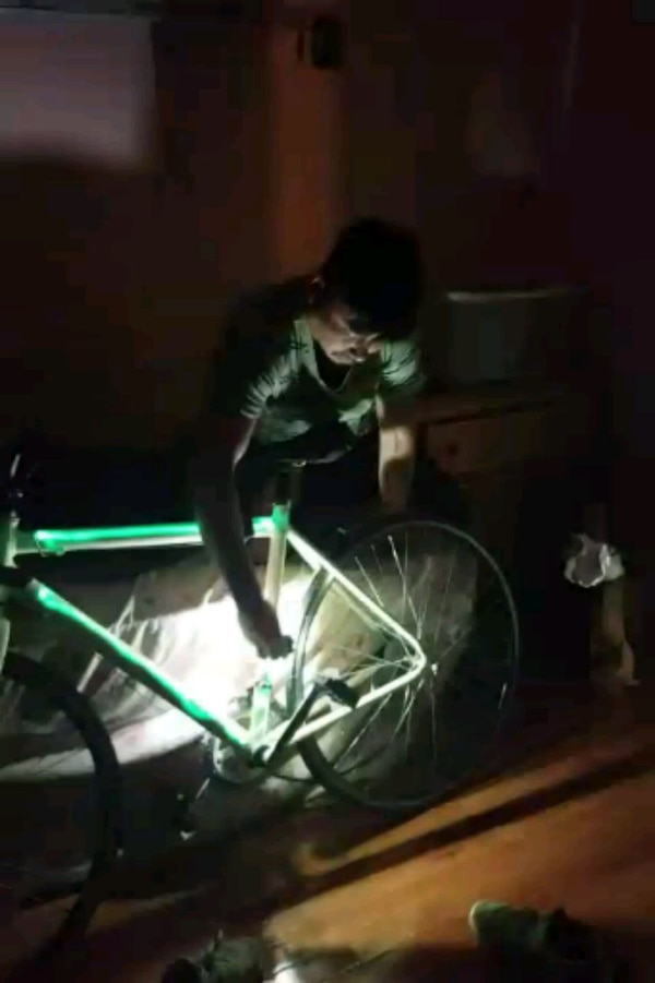 Road bike with light activated glow paint