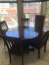 round/ oblong Dining table- 4 chairs + 18in leaf extension Orlando, 32837