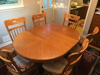 oval brown wooden dining table with chairs set Caldwell, 07006
