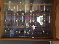 Spoon collection from around the world in brown cabinet under glass very old past down to me Port Coquitlam, V3B 1W5