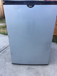Grey and black Oster compact refrigerator Lake Elsinore, 92530