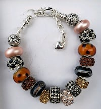 Brown, black gold charm bracelet 2 for $25 Baltimore, 21224