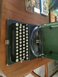 black and gray typewriter in case Hagerstown, 21740