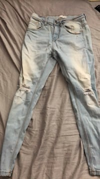 Light blue ripped skinny jeans size 31