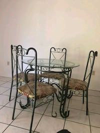 round glass-top table with four chairs Kissimmee, 34741