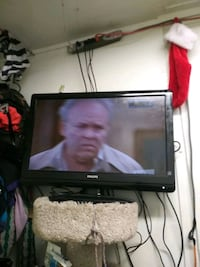 black flat screen TV with remote San Francisco, 94132