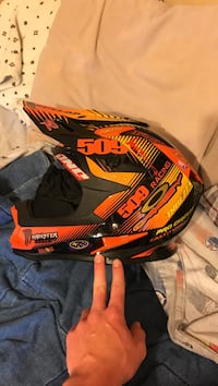 Orange and black motocross helmet