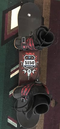 red and black snowboard with bindings