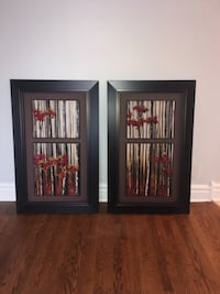 two black wooden photo frames Montréal, H1P 1S3
